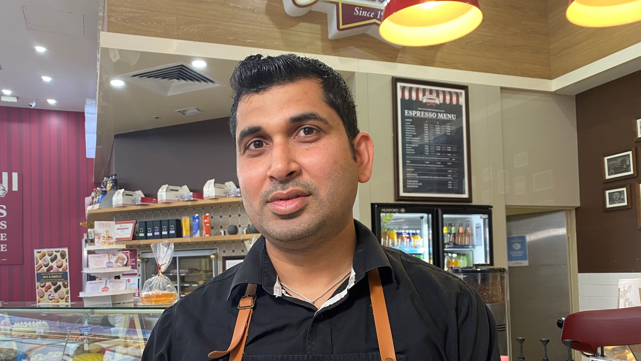 Pranay Mahajan is a franchisee of the bakery chain Ferguson Plarre with one store in Melbourne. (ABC News: Emilia Terzon)